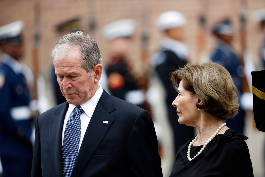George W. Bush gives Michelle Obama candy at father's funeral""