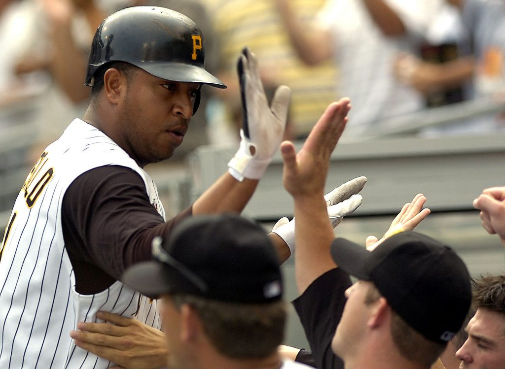 Pittsburgh Pirates' Jose Castillo is greeted in the dugout by teammates after hitting a game-tying solo home run in the bottom of the ninth off San Francisco Giants closer Armando Benitez during a baseball game in Pittsburgh. Former Major League Baseball players Luis Valbuena and Jose Castillo have been killed in a car crash in Venezuela. MLB tweeted late Thursday, Dec. 6, 2018, the 33-year-old Valbuena and 37-year-old Castillo died. Both were playing for Cardenales de Lara in the Venezuelan league.