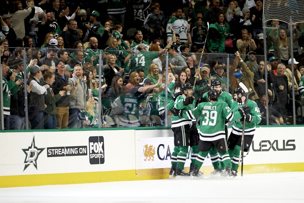 Dallas Stars center Mattias Janmark (13) celebrates with teammates after scoring a goal against the San Jose Sharks on Friday in Dallas.