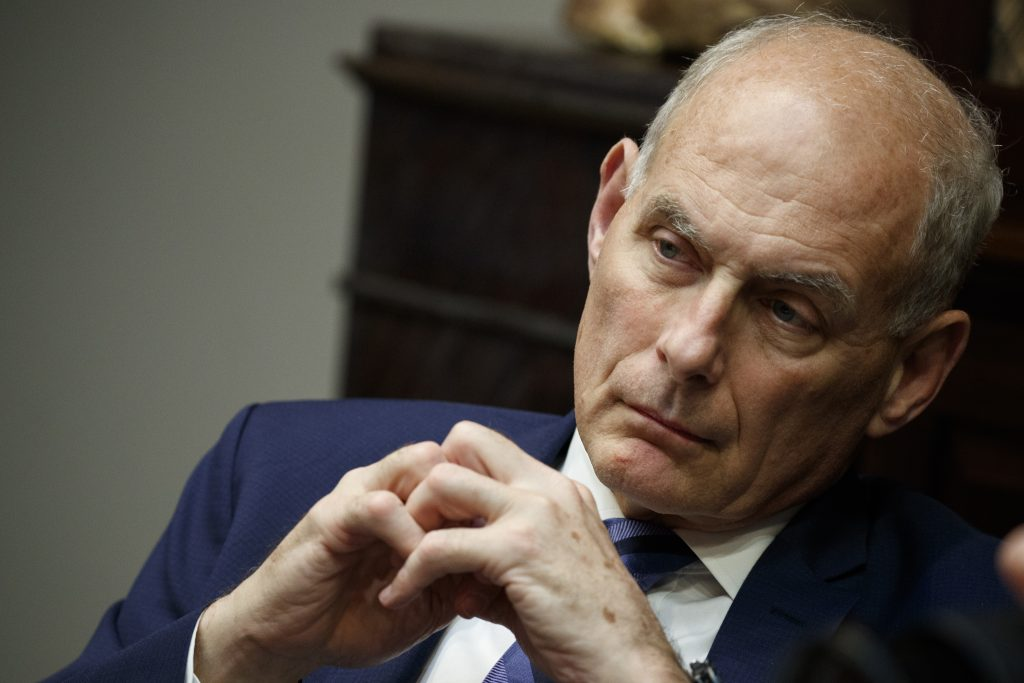 White House Chief of Staff John Kelly listens as President Trump speaks at a lunch with governors in June. Kelly will leave his job at the end of the year, leaving Trump to find a successor.