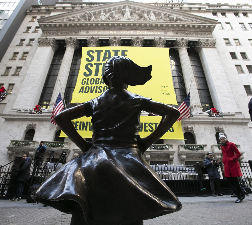 The Fearless Girl statue is unveiled at its new location in front of the New York Stock Exchange, Monday, Dec. 10, 2018, in New York. The statue, considered by many to symbolize female empowerment, was previously located near the Charging Bull statue on lower Broadway.