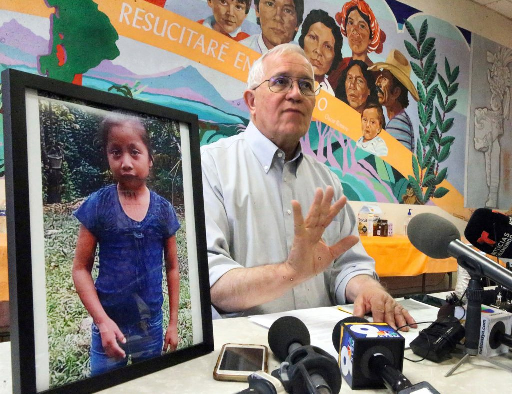 Annunciation House director Ruben Garcia answers questions from the media after reading a statement from the family of Jakelin Caal Maquin, pictured at left, during a news briefing at Casa Vides on Saturday in downtown El Paso, Texas. Maquin had received her first pair of shoes several weeks ago, when her father said they would set out together for the U.S., thousands of miles from her impoverished Guatemalan village. Instead she died in a Texas hospital two days after being taken into custody by U.S. Border Patrol agents in a remote stretch of New Mexico desert.