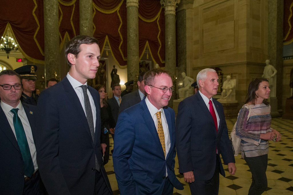 From left, White House senior adviser Jared Kushner, incoming White House Chief of Staff Mick Mulvaney and Vice President Mike Pence leave meetings to try to persuade senators to pass a bill that would pay for President Trump's border wall and avert a partial government shutdown, on Capitol Hill on Friday.