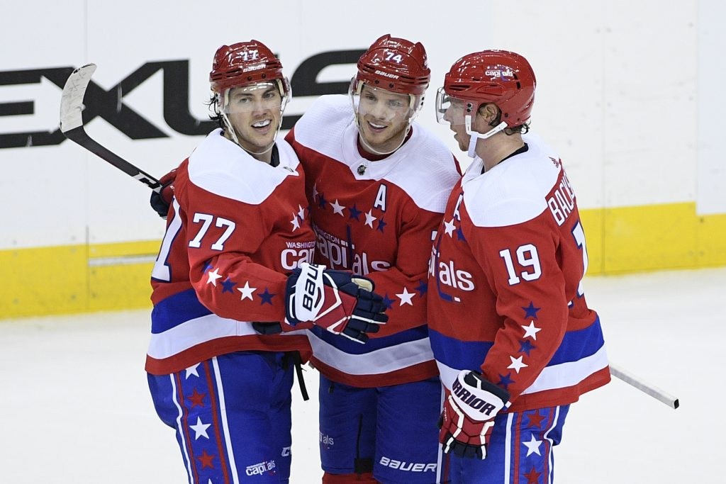 Washington Capitals defenseman John Carlson (74) celebrates his goal with right wing T.J. Oshie (77) and center Nicklas Backstrom (19) Thursday in Washington.