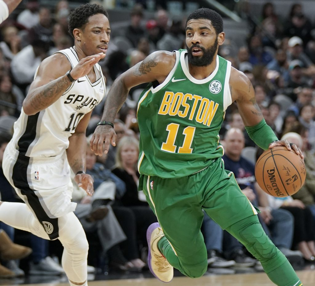 Boston's Kyrie Irving drives against San Antonio Spurs' DeMar DeRozan during the second half of the Celtics' 120-111 loss on Monday in San Antonio.