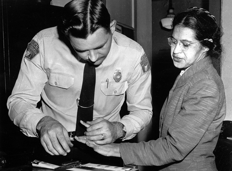 Rosa Parks is fingerprinted by police Lt. D.H. Lackey in Montgomery, Ala., Feb. 22, 1956, two months after refusing to give up her seat on a bus for a white passenger on Dec. 1, 1955.