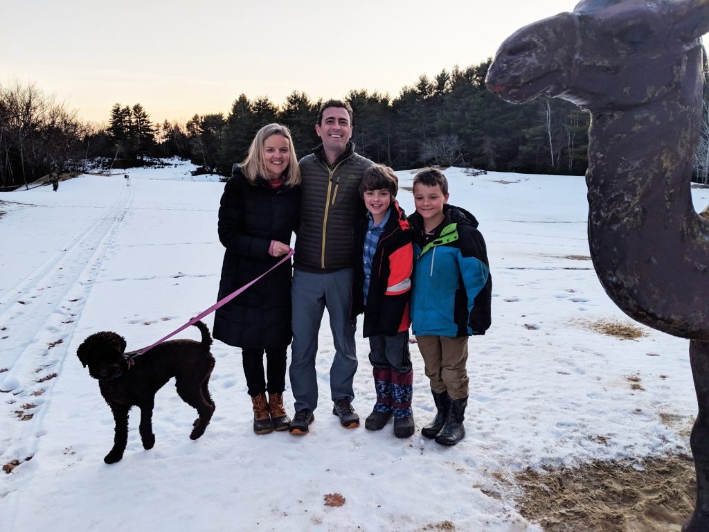 Mela and Doug Heestand, new owners of the Desert of Maine, pose near the attraction's camel statue with their sons Nicky, right, and William, and their dog Autumn.