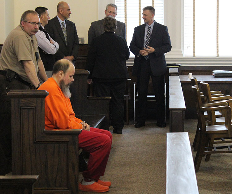 Rondon Athayde, 46, sits in Oxford County Superior Court on Friday morning as he waits for his initial court appearance in the death of his longtime girlfriend, Ana Cordeiro.