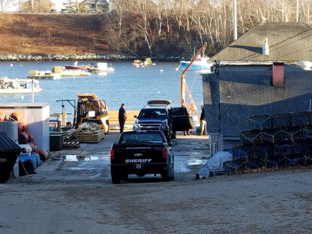 "Police arrive at Bailey Island Lobster Company, after a projectile labeled ""live round"" was brought in on a fishing boat."