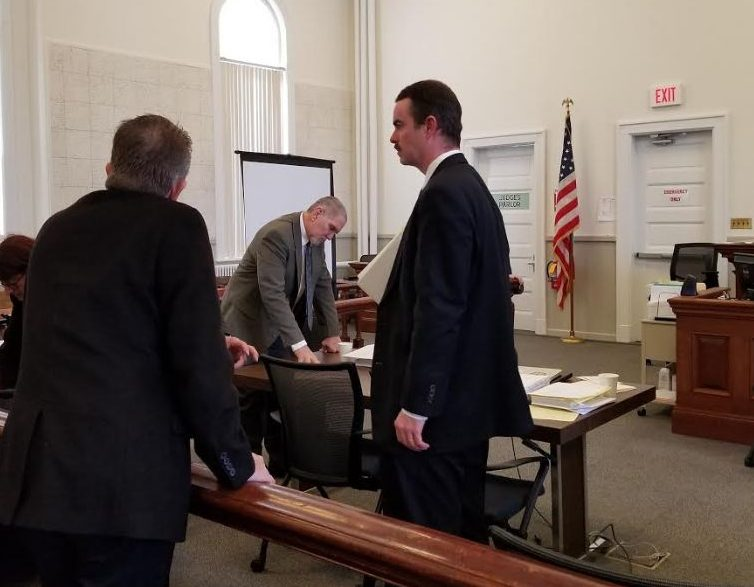 "James ""Ted"" Sweeney, center, is on trial on a charge of murder in the death of his former girlfriend, Wendy Douglass, 51, of Jay on July 11, 2017, while she slept at her home. Sweeney's co-defense attorney Thomas J. Carey, right, and a private investigator are seen during a break in the trial Monday in Franklin County Superior Court."
