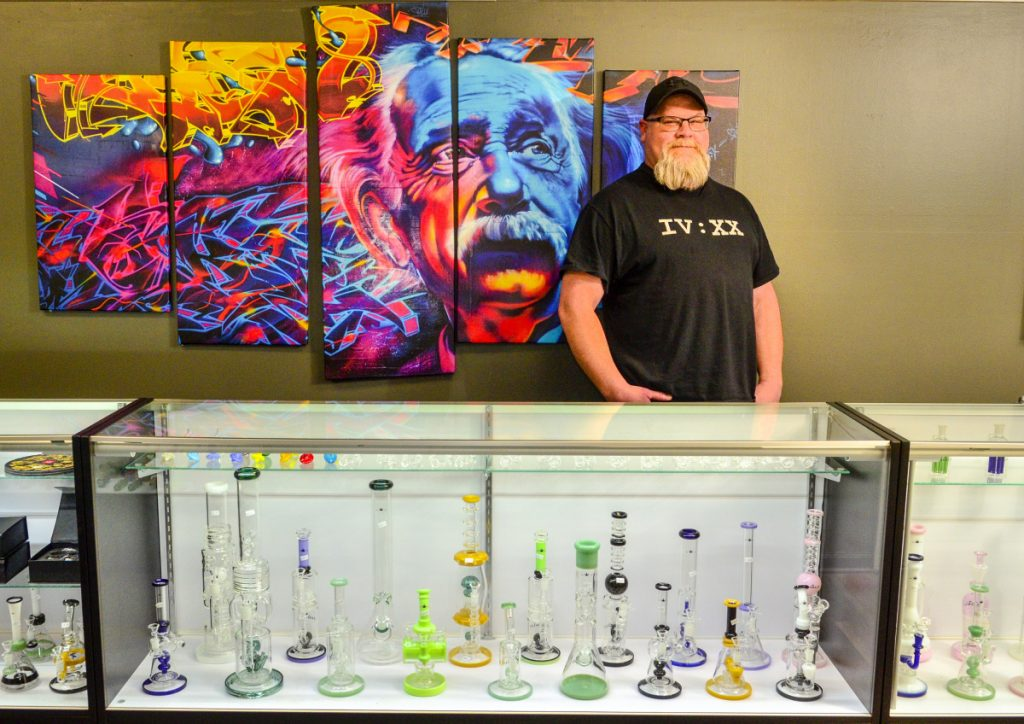 Owner-operator Derek Wilson poses for a portrait Dec. 13 at The Cannabis Healing Center in Hallowell.
