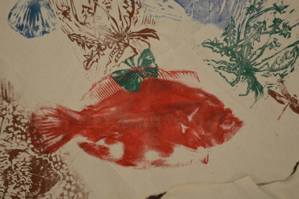 A detail shot of a fish on the cloth map used to represent Native American land, waterways, and plants and animals in Maine before European settlers reached North America, during a Maine-Wabanaki REACH presentation Sunday at the Unitarian Universalist Community Church of Augusta.