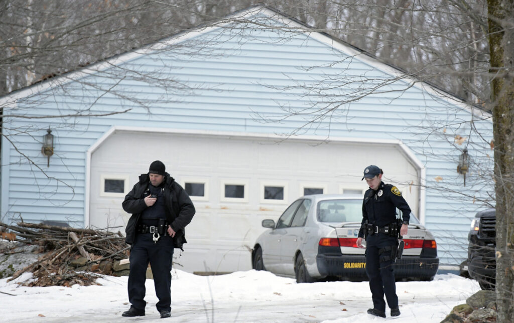 Augusta Police officers Don Whitten, left, and Sara Rogers search near a residence Sunday on Route 105 in Augusta following a report of shots fired. Several officers searched the residence before turning the building over to detectives. Augusta Police Sgt. Chris Shaw said the incident remains under investigation.