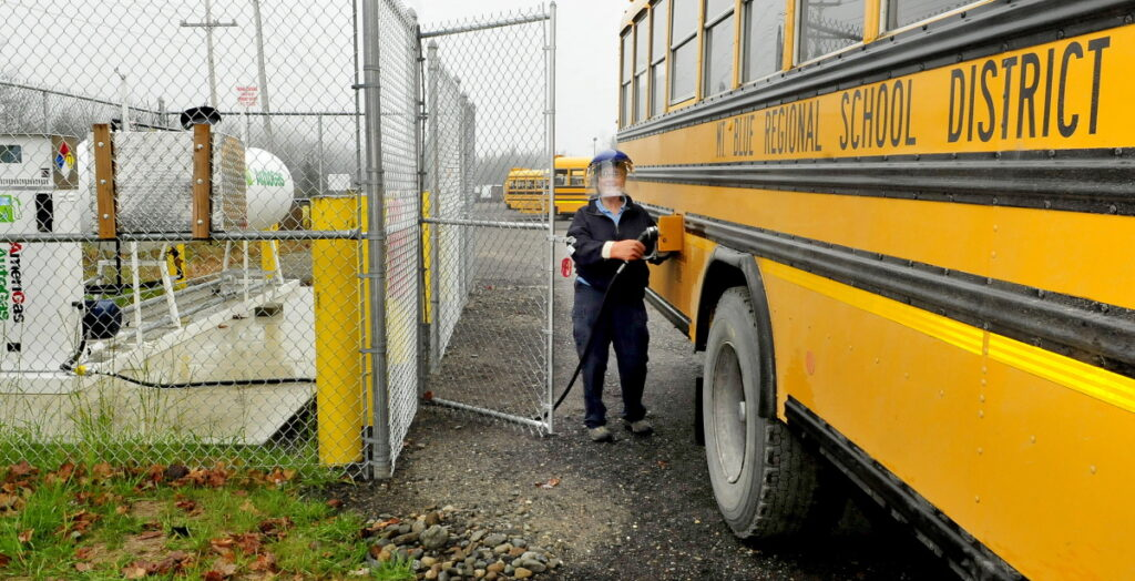 Regional School Unit 9 bus driver Nancy Richardson dons protective gear while filling one of four new buses with propane rather than diesel on Oct. 29, 2014. A threat claiming a bomb was on a bus was called into RSU 9 at around 3:30 p.m. Thursday. Authorities were dropping school children off at fire stations and searching the buses into the evening.