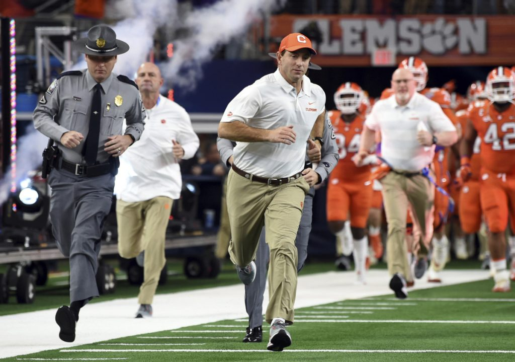 Clemson head coach Dabo Swinney jogs onto the field for the first half of the NCAA Cotton Bowl semi-final playoff football game against Notre Dame on Saturday Dec. 29 2018 in Arlington Texas