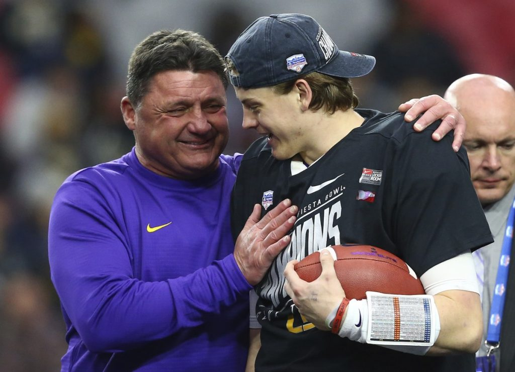 LSU Coach Ed Orgeron, left, celebrates with quarterback Joe Burrow, right, after the Tigers beat Central Florida 40-32 in the Fiesta Bowl on Tuesday in Glendale, Arizona.