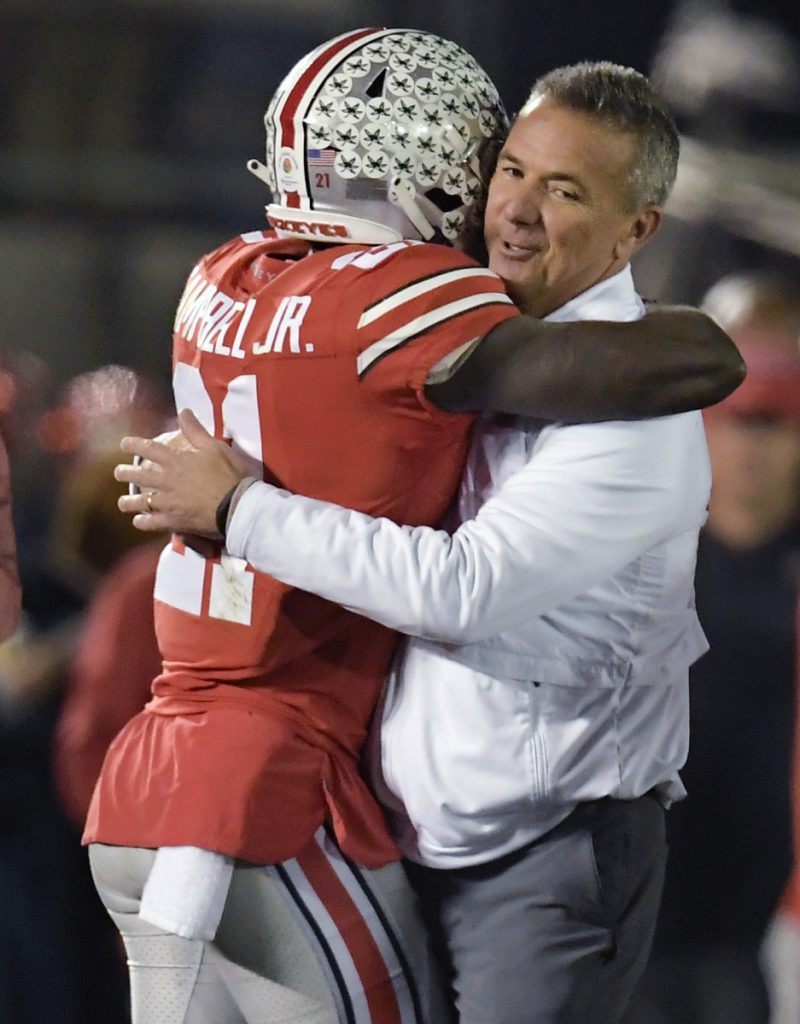 Ohio State Coach Urban Meyer, right, hugs wide receiver Parris Campbell after the Buckeyes won the Rose Bowl 28-23 win over Washington.