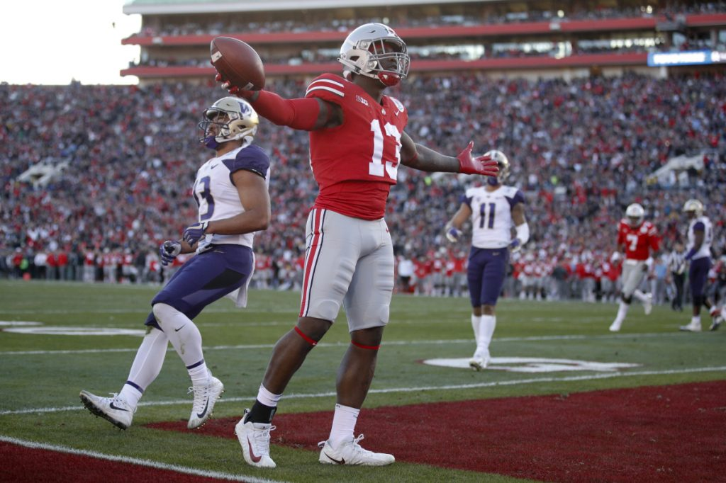 Ohio State tight end Rashod Berry looks to the crowd after scoring a touchdown against Washington during the first half of the Rose Bowl on Tuesday. Ohio State won, 28-23.