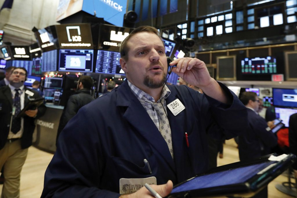 Trader Michael Milano works the floor of the New York Stock Exchange on Wednesday as the markets reopen after their worst year in a decade.