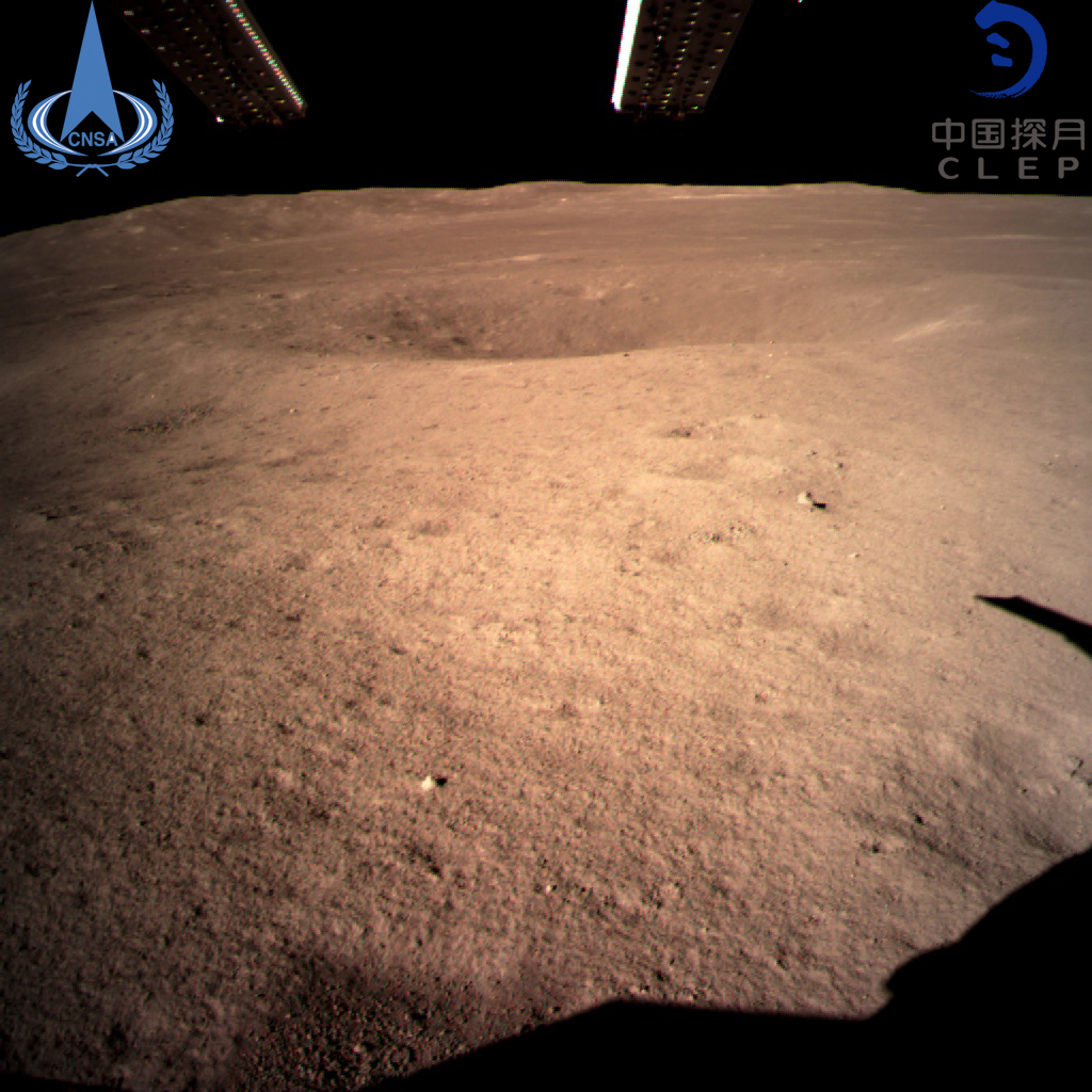 One of the first photographs from China's Chang'e 4 spacecraft shows a small crater. The landing is the first in history on the 'dark' side of the moon.