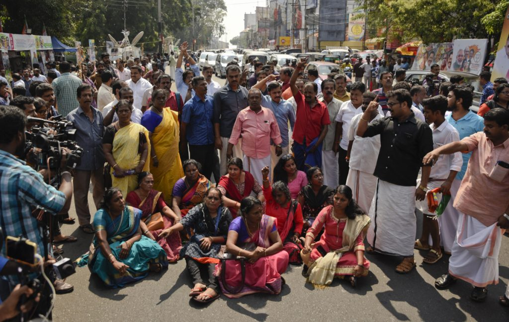 Protesters block traffic and shout slogans reacting to reports of two women of menstruating age entering the Sabarimala temple, one of the world's largest Hindu pilgrimage sites, in Thiruvananthapuram, Kerala, India, on Wednesday. The historic temple had barred women of menstruating age from entering the temple. India's Supreme Court on September 28th lifted the ban, holding that equality is supreme irrespective of age and gender. (AP Photo/R S Iyer)