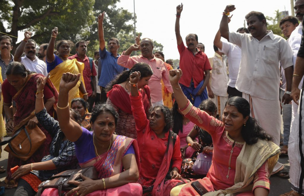 Protests erupt after two women make landmark step in Indian temple