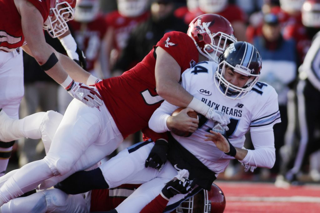 Eastern Washington defensive lineman Mitchell Johnson, left, sacks Maine quarterback Chris Ferguson during the first half of an NCAA college football FCS semifinal game in Cheney, Wash., Saturday, Dec. 15, 2018. (Photo by Young Kwak)