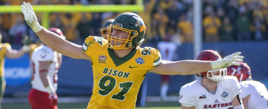 North Dakota State defensive end Derrek Tuszka waves his arms like an eagle – Eastern Washington's mascot – after sacking quarterback Eric Barriere in the final minutes of a 38-24 victory in the FCS championship game Saturday at Frisco, Texas.