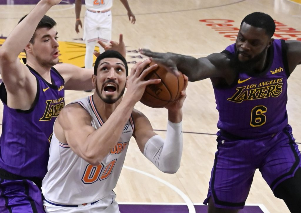Knicks center Enes Kanter, center, will not travel to London for New York's game against Washington because he fears he could be killed because of his opposition of Turkish President Tayypi Erdogan.