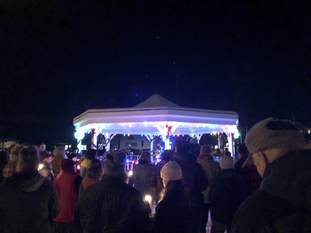 Friends, family and community members gather Saturday night in South Paris to remember Heather Bickford and Dana Hill, who were found dead in their apartment last Tuesday.
