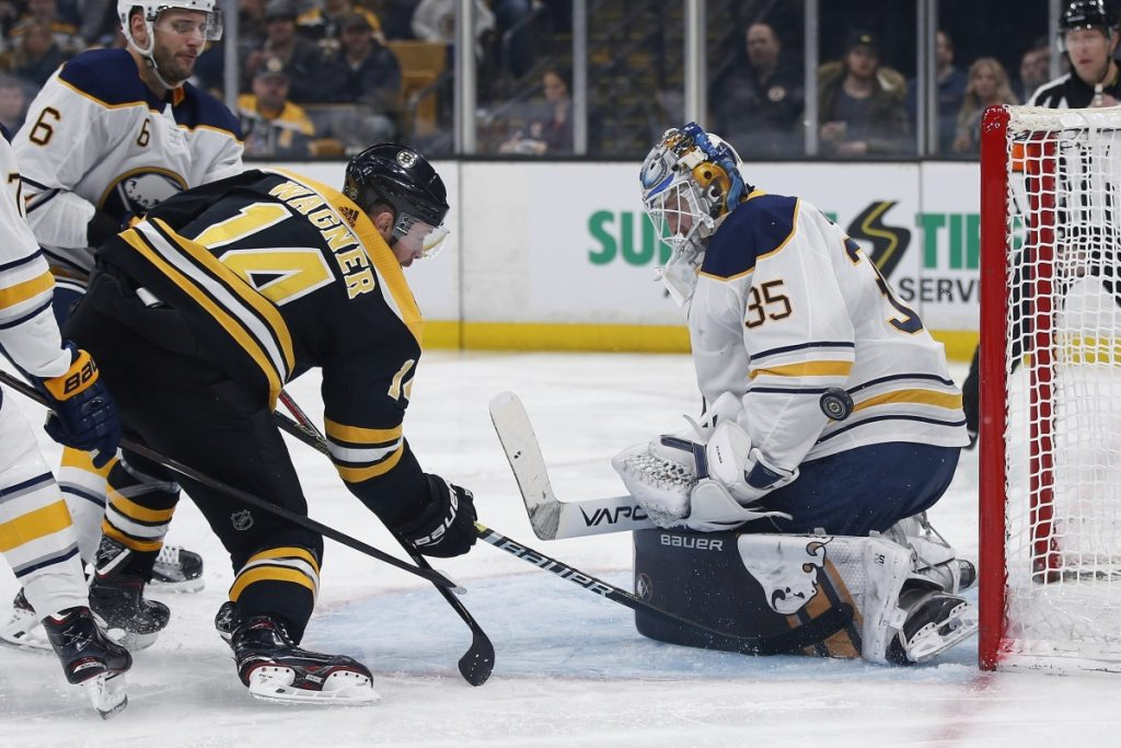 Sabres goalie Linus Ullmark blocks a shot by Boston's Chris Wagner, who scored the Bruins' first goal in a 2-1 victory.