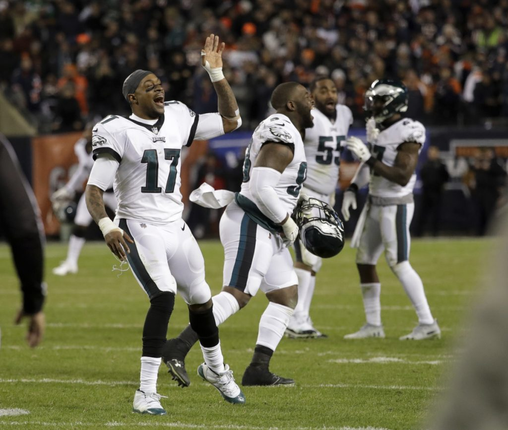 Alshon Jeffery, left, and his Eagles teammates celebrate after a potential winning field goal by Bears kicker Cody Parkey clanged off both the left upright and the crossbar.