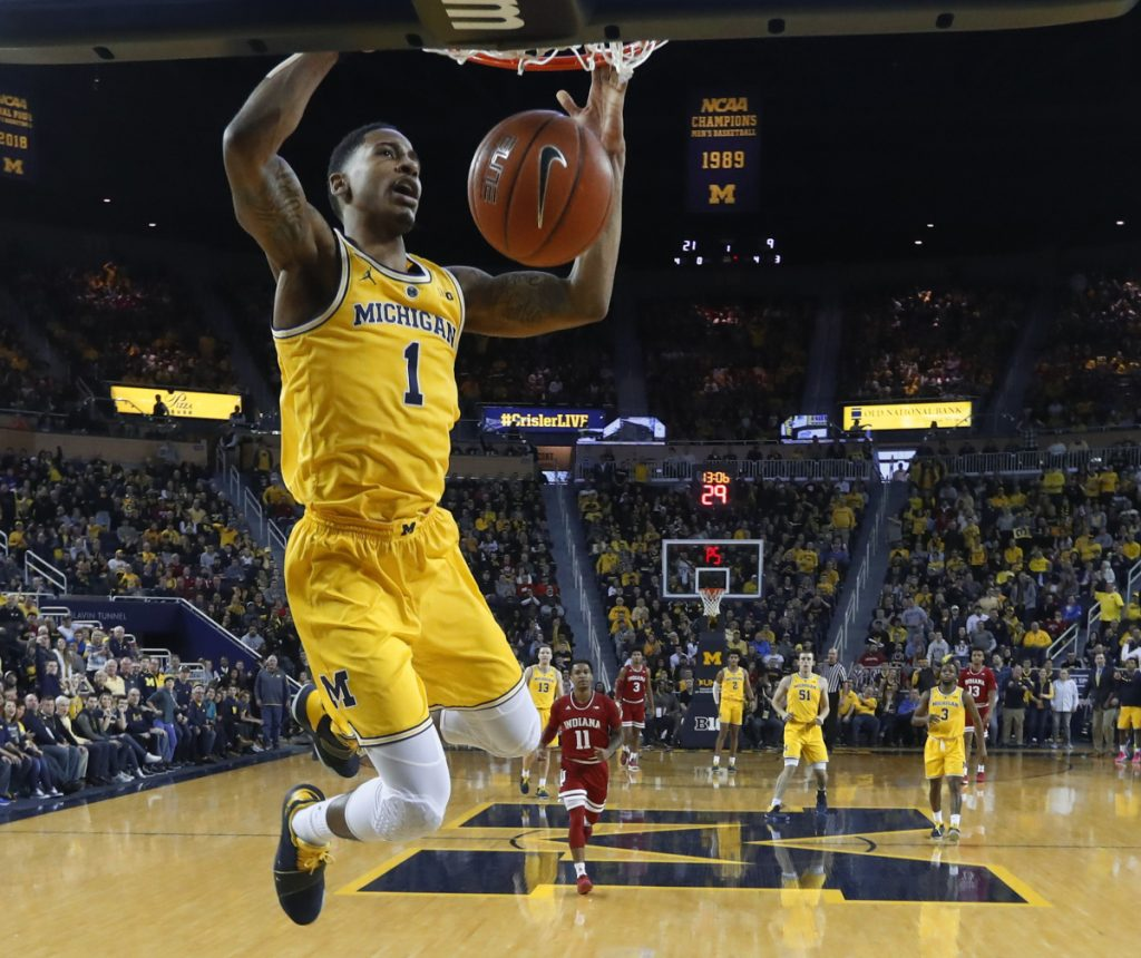 Charles Matthews of Michigan dunks during the first half of a 74-63 victory against Indiana on Sunday at Ann Arbor, Mich. The second-ranked Wolverines improved to 15-0.