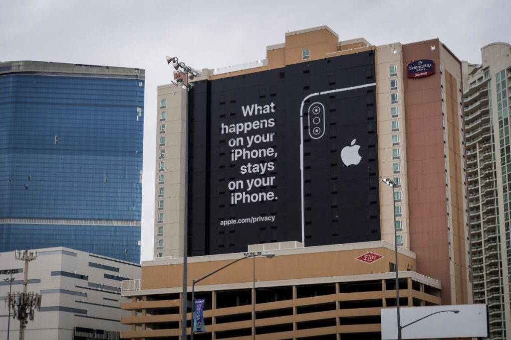 A billboard touts the data security of Apple iPhones in Las Vegas, site of the annual consumer technology conference. Tech giants Google and Samsung are there but Apple is not, yet that didn't stop it from taking a jab at Google, its Silicon Valley rival.