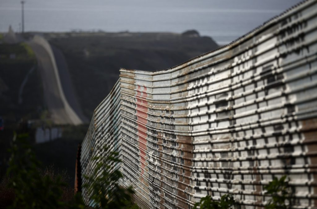 A section of a wall on the Mexican border stretches toward the Pacific Ocean near Tijuana, Mexico. In Washington, the standoff over President Trump's demand for funding for a new wall continued Tuesday.