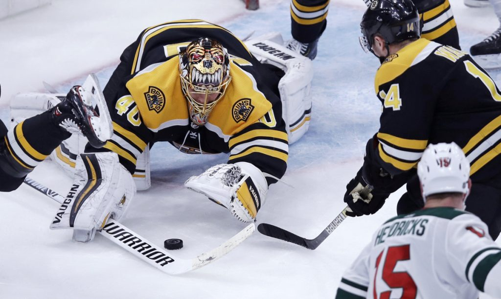 Boston goaltender Tuukka Rask pounces onto the puck during Tuesday's game against Minnesota in Boston. Rask made 24 saves in a 4-0 win.