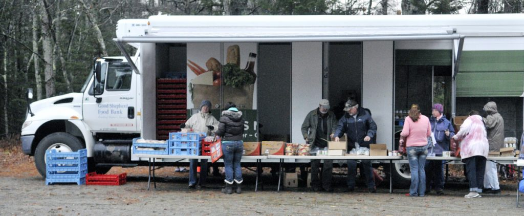 """Volunteers distribute food at a mobile pantry in Jefferson. A promo for the Food section saying """"Hope you're hungry"""" was insensitive, a reader says."""
