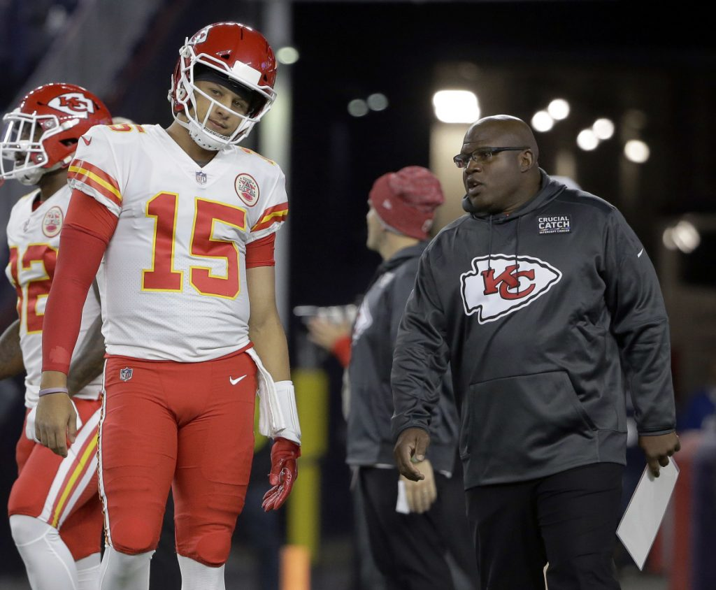 The emergence of Chiefs quarterback Patrick Mahomes, left, was aided by offensive coordinator Eric Bieniemy, who is a candidate for open NFL head coaching jobs.