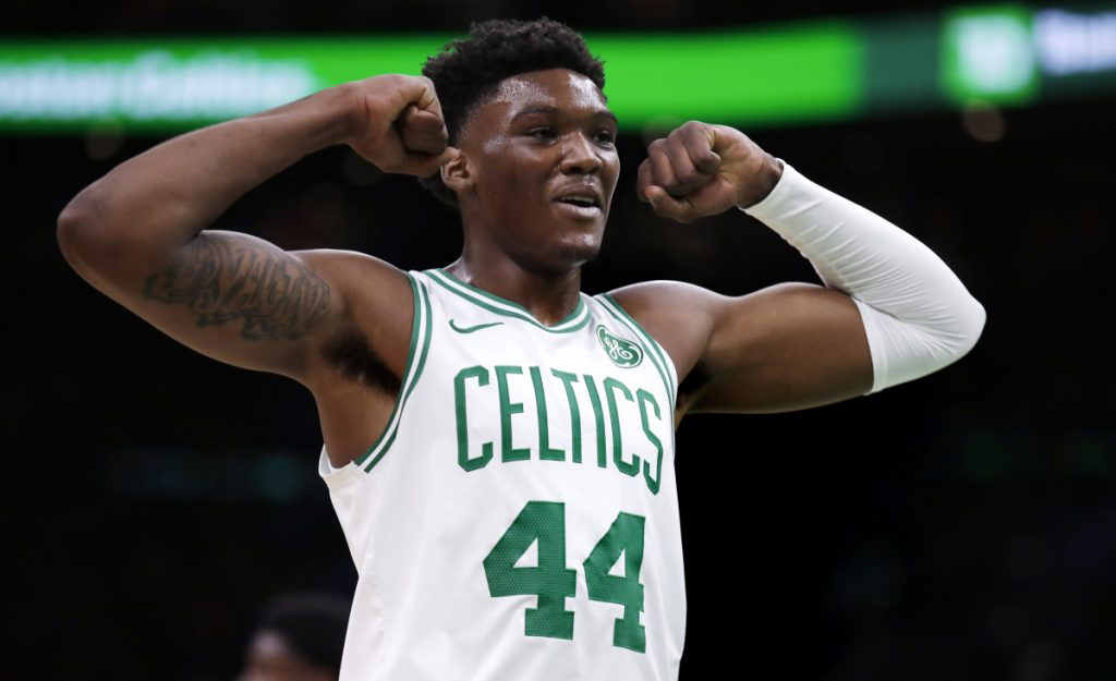 Boston center Robert Williams flexes during the second half of Wednesday's game against the Indiana Pacers in Boston.