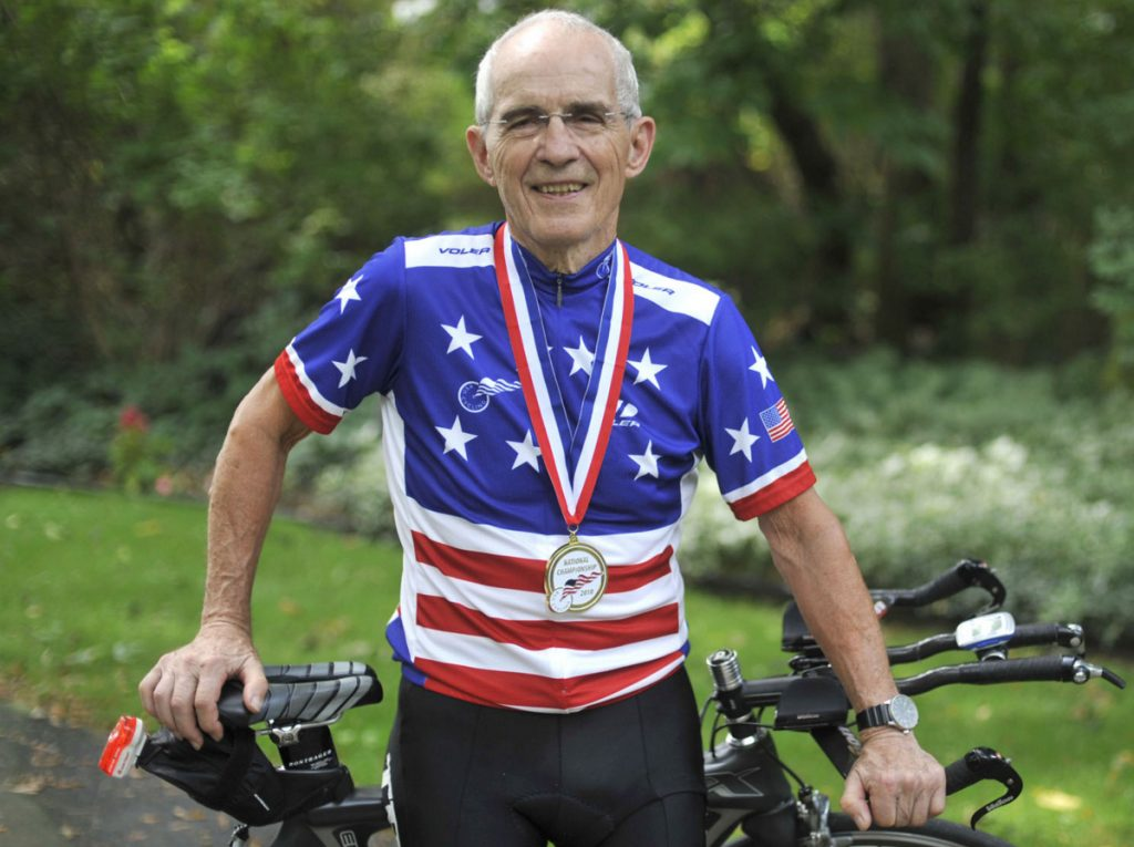 Carl Grove, seen here outside his Indiana home in 2010, has racked up 18 national titles while setting age-group cycling records.