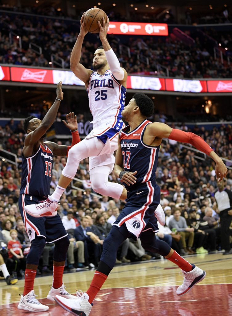 Philadelphia guard Ben Simmons goes to the basket between Otto Porter Jr., left, and Jeff Green of the Wizards during's Wednesday's game in Washington.