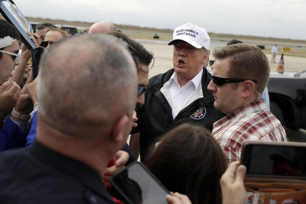 President Trump greets people after arriving at McAllen International Airport for a visit to the southern border on Thursday in McAllen, Texas.