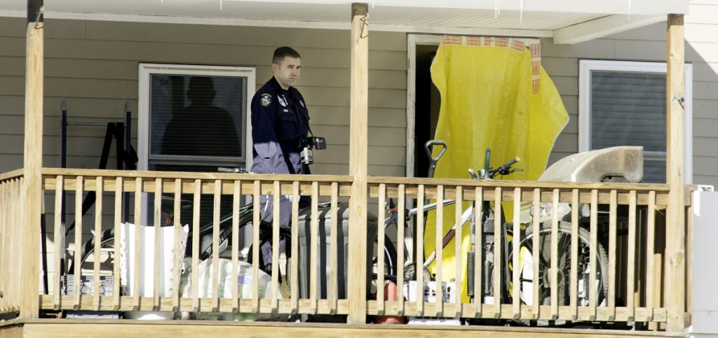 On Jan. 2, state police evidence technicians enter the South Paris apartment where a man and a woman were found dead Jan. 1. Their daughters, a 2-month-old infant and an 8-year-old, were also in the apartment and are now in state custody. Sun Journal photo by Daryn Slover