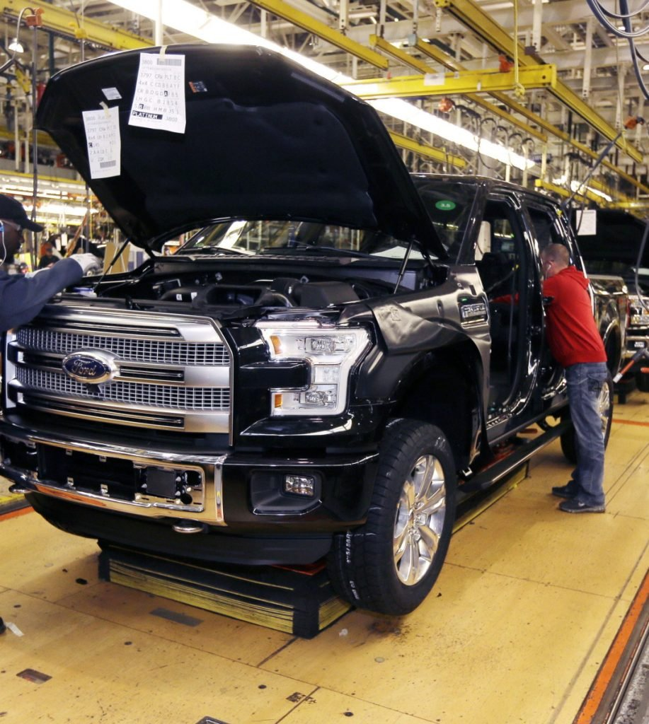 A Ford F-150 truck is assembled at the Rouge Truck Plant in Dearborn, Mich., in 2014.
