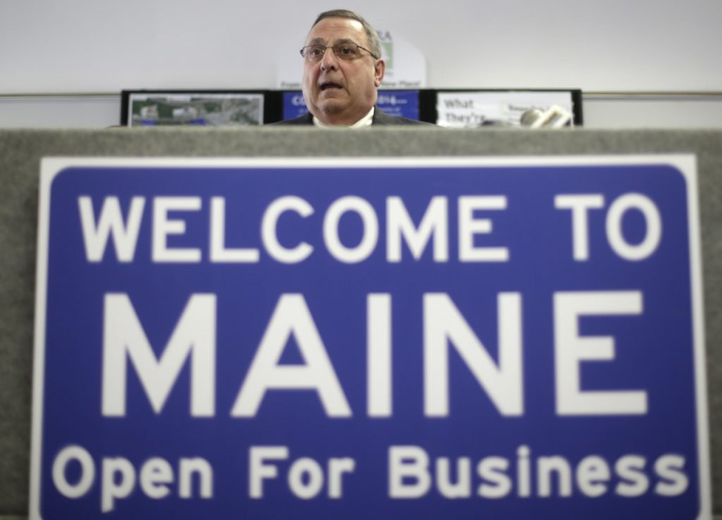 "Former Gov. Paul LePage speaks at a news conference where he touted his ""Open for Business"" sign in Brunswick in 2014."