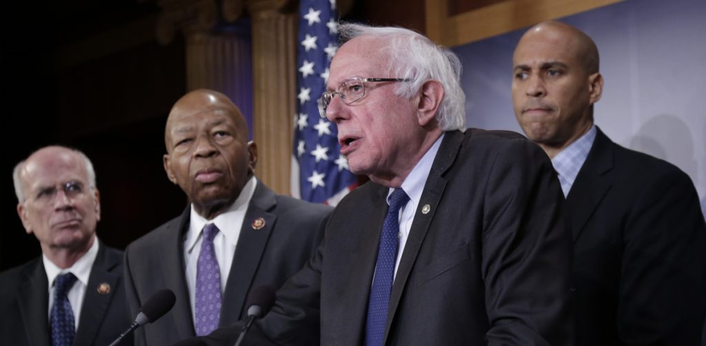 Sen. Bernie Sanders, I-Vt., center, joined from left by Rep. Peter Welch, D-Vt., Rep. Elijah Cummings, D-Md., and Sen. Cory Booker, D-N.J., leads efforts to reduce the cost of prescription drugs.