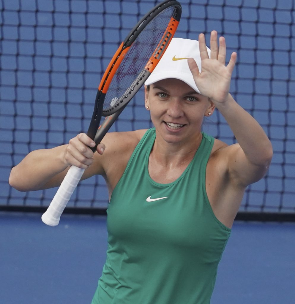 Simona Halep, of Romania, acknowledges the crowd after defeating Aryna Sabalenka, of Belarus, during the semifinals at the Western & Southern Open tennis tournament, Saturday, Aug. 18, 2018, in Mason, Ohio. (AP Photo/John Minchillo)