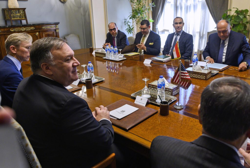U.S. Secretary of State Mike Pompeo, second from left, meets with Egyptian Foreign Minister Sameh Shoukry, second from right, and the delegation in Cairo before his speech at American University.