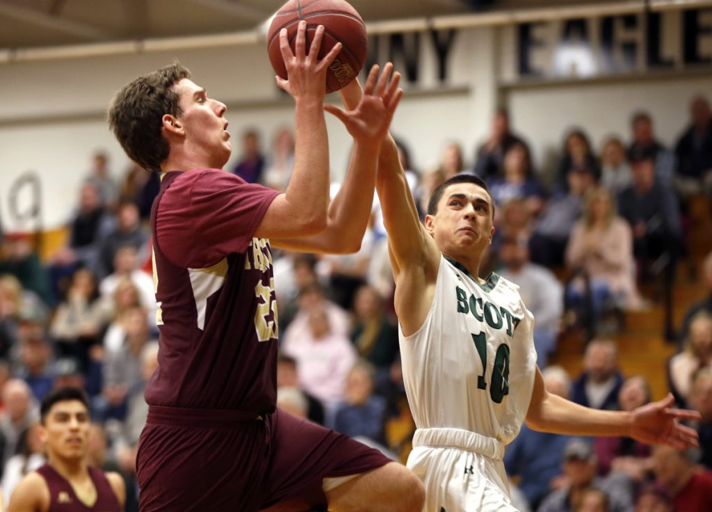 Jack Humphrey, right, of Bonny Eagle, tries to stop a drive to the basket by Thornton Academy's Robert Gawronski during a Class AA South game Thursday in Standish. Gawronski scored 10 points in a 70-62 victory.