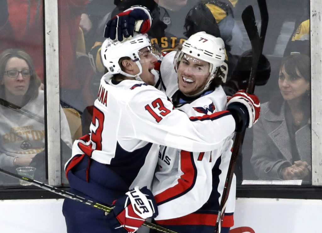 Washington Capitals left wing Jakub Vrana (13) celebrates his goal with teammate T.J. Oshie Thursday against the Bruins in Boston. ()